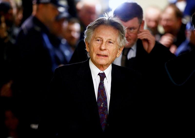 Filmmaker Roman Polanski walks on a corridor during a break of a court hearing in Krakow February 25, 2015. (Reuters Photo)