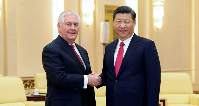 U.S. State of Secretary Rex Tillerson, Left, shakes hands with China's President Xi Jinping at the Great Hall of the People in Beijing, China Sunday, March 19.