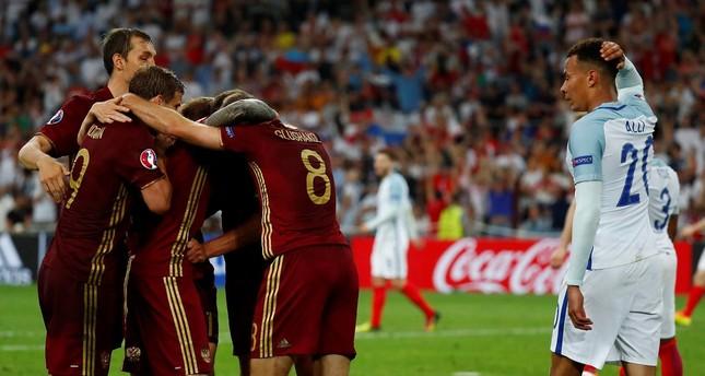 Russia's Vasili Berezutski celebrates after scoring their first goal as England's Dele Alli looks dejected (REUTERS Photo)