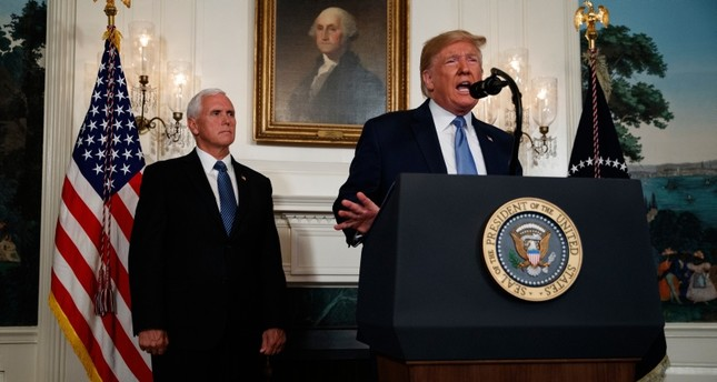 Vice President Mike Pence listens as President Donald Trump speaks about the mass shootings in El Paso, Texas and Dayton, Ohio, in the Diplomatic Reception Room of the White House, Monday, Aug. 5, 2019, in Washington. (AP Photo)