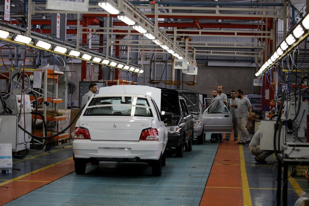 Cars are seen inside the Saipa Syria Factory in the industrial city of Hassia in Homs.