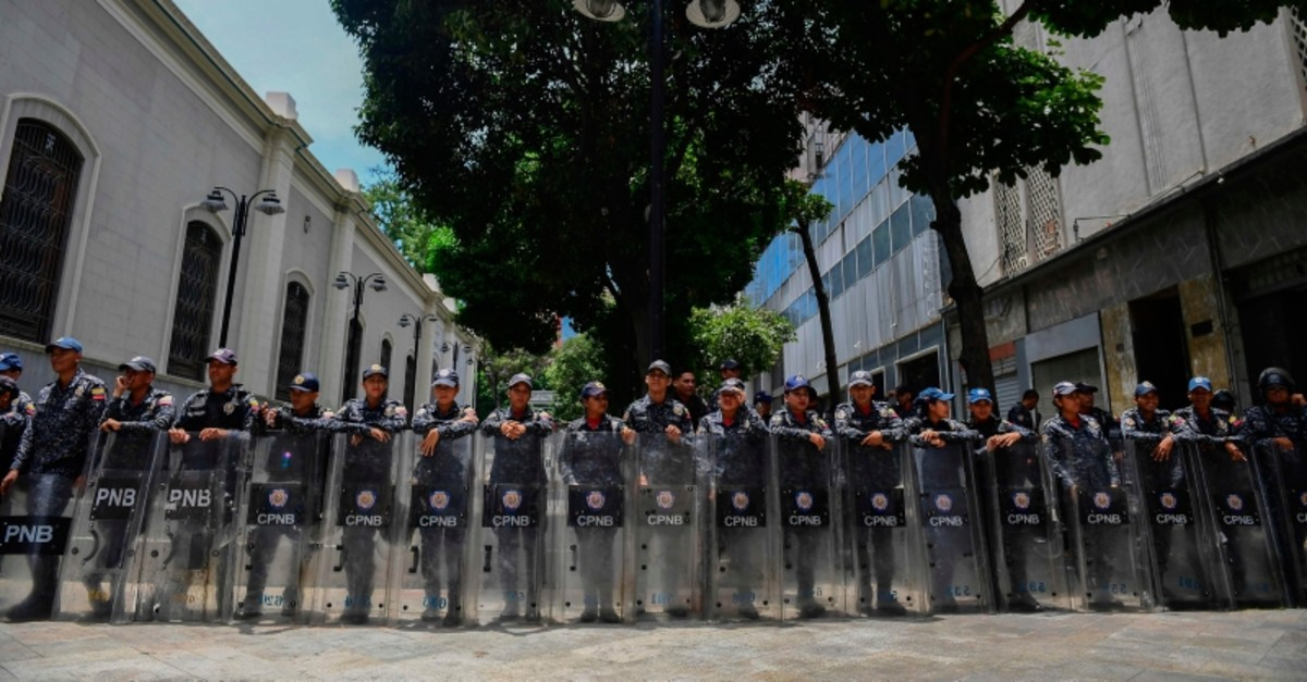 Members of Venezuela's Bolivarian National Police stand guard in the surroundings of the Federal Legislative Palace in Caracas on May 14, 2019. (AFP Photo)