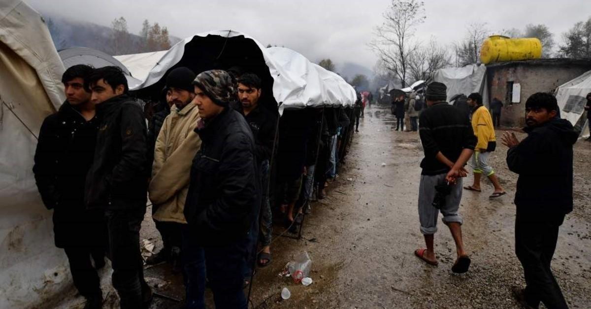 Migrants line up for lunch distribution at Vucjak camp, Bihac, Nov. 20, 2019. (AFP Photo)