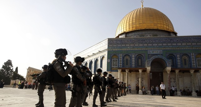 Israeli border police officers stand near the Dome of the Rock Mosque in the Al-Aqsa Mosque compound in Jerusalem's Old City, July 27.