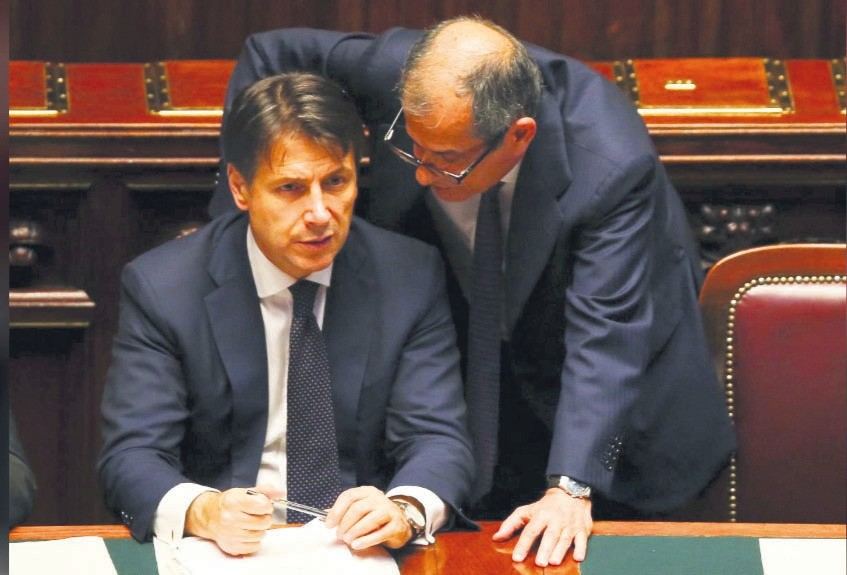 Italian Prime Minister Giuseppe Conte talks with Economy Minister Giovanni Tria during his first session at the Lower House of the Parliament in Rome, Italy, June 6.