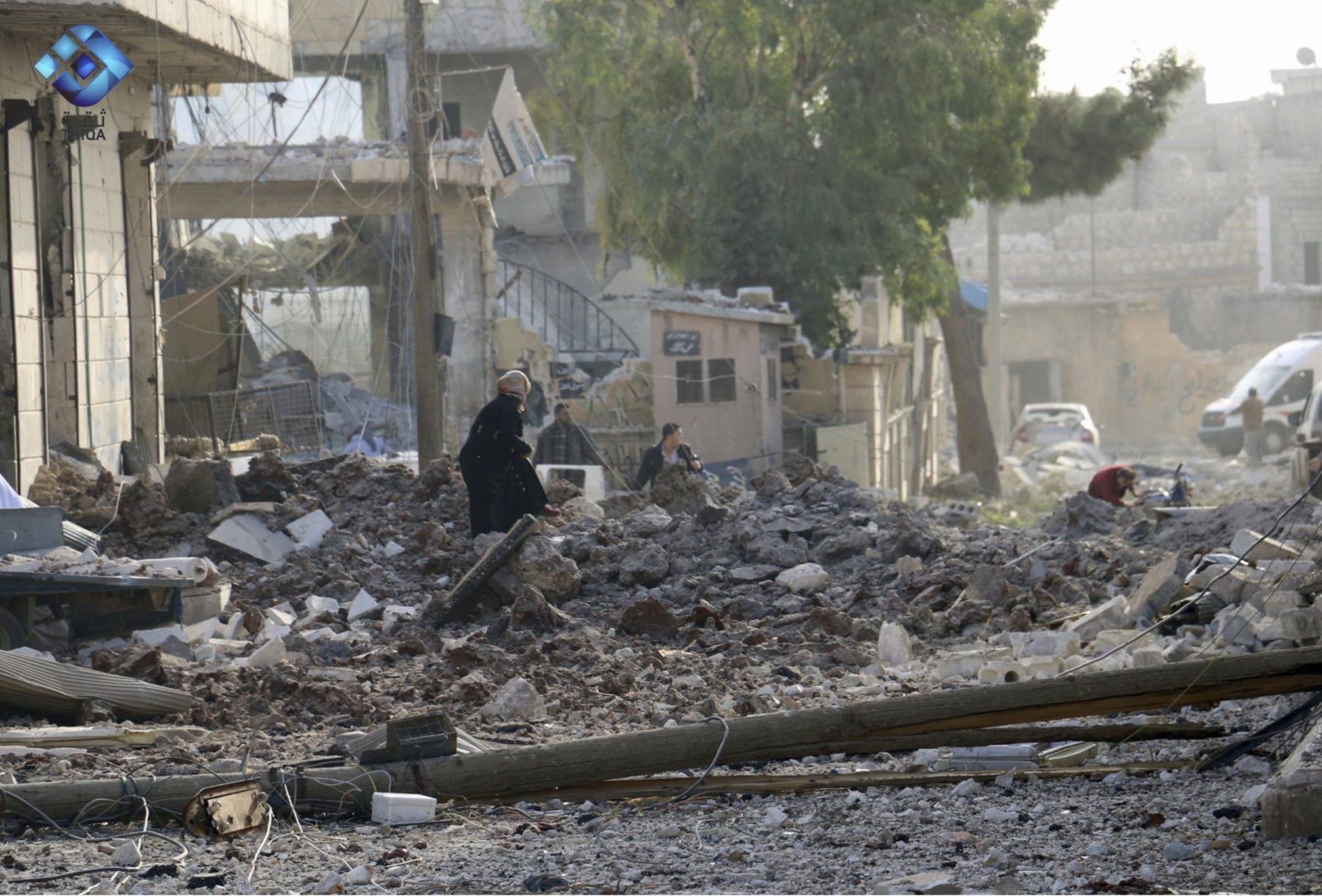 This image shows people inspecting damage from airstrikes on Atareb, in the opposition-held countryside outside Aleppo Syria, Monday, Nov. 13, 2017. (Thiqa News via AP)
