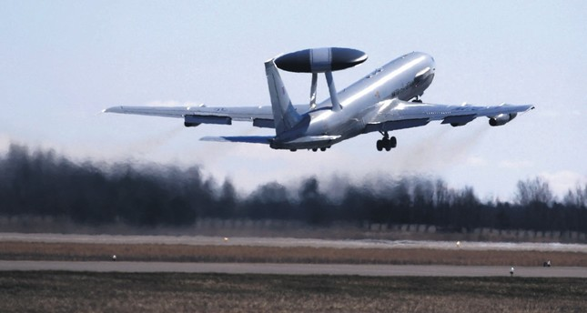 A NATO Airborne Warning and Control System (AWACS) aircraft take off during the Lithuanian - NATO air force exercise at the Siauliai Air Base some 230 kilometers east of the capital, Vilnius, Lithuania, April 1, 2014.