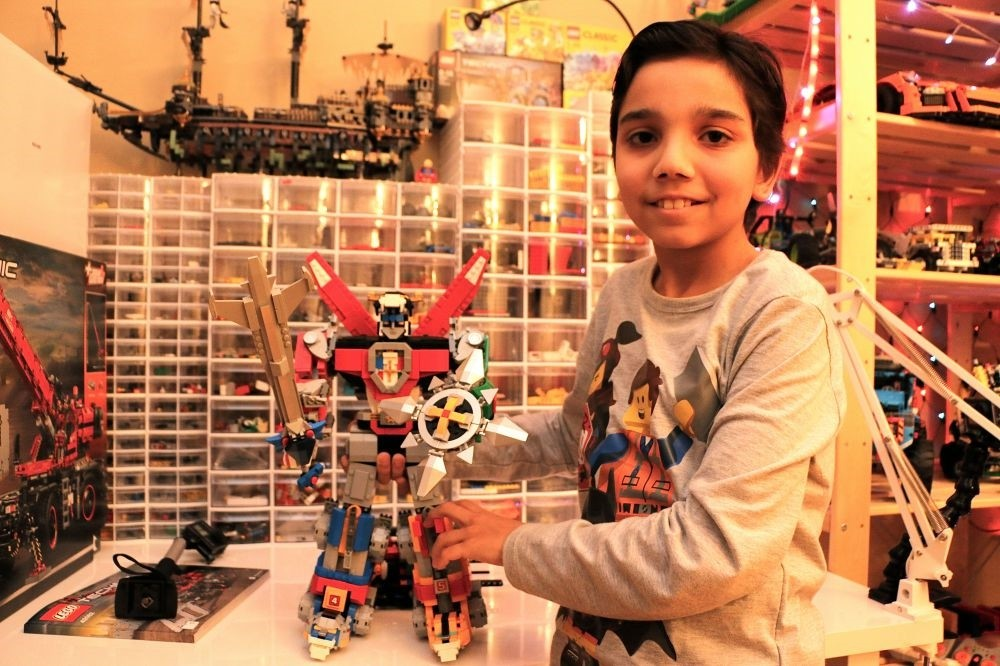 Efe Bilgili poses with a figure he made from Legos.