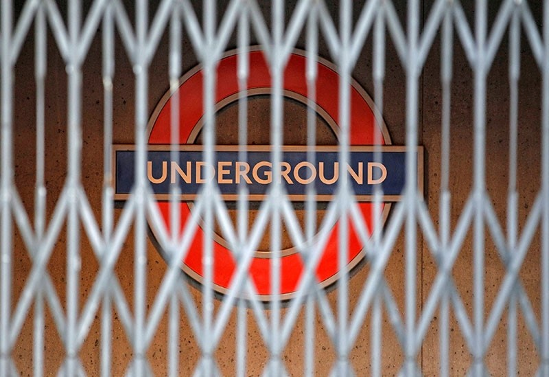 This file photo shows a London Underground sign is seen behind a locked gate, in central London, Dec. 26, 2010. (Reuters Photo)