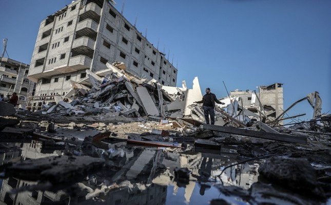 A Palestinian inspects a rubble of a destroyed building of Al-Aqsa channel belonging to Hamas movement after Israeli air strike in Gaza City, Nov. 13, 2018.