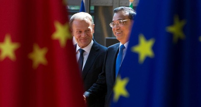 Donald Tusk, President of the European Council, and Chinese Premier Li Keqiang (R). (REUTERS Photo)