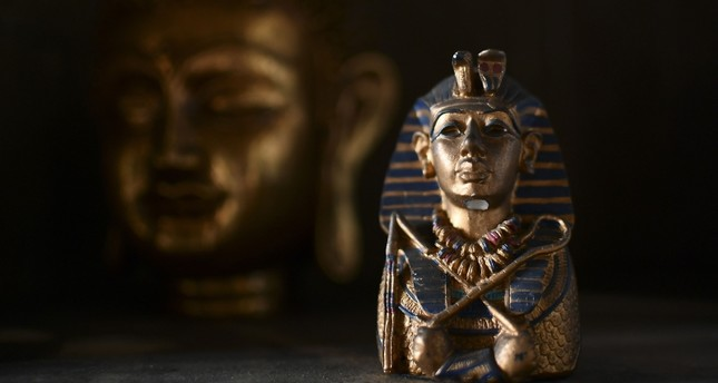 A photo taken on June 24, 2017 shows a small a sculpture of Egyptian pharaoh Tutankhamun at the Universal Temple in Kazan, Russia (AFP Photo)