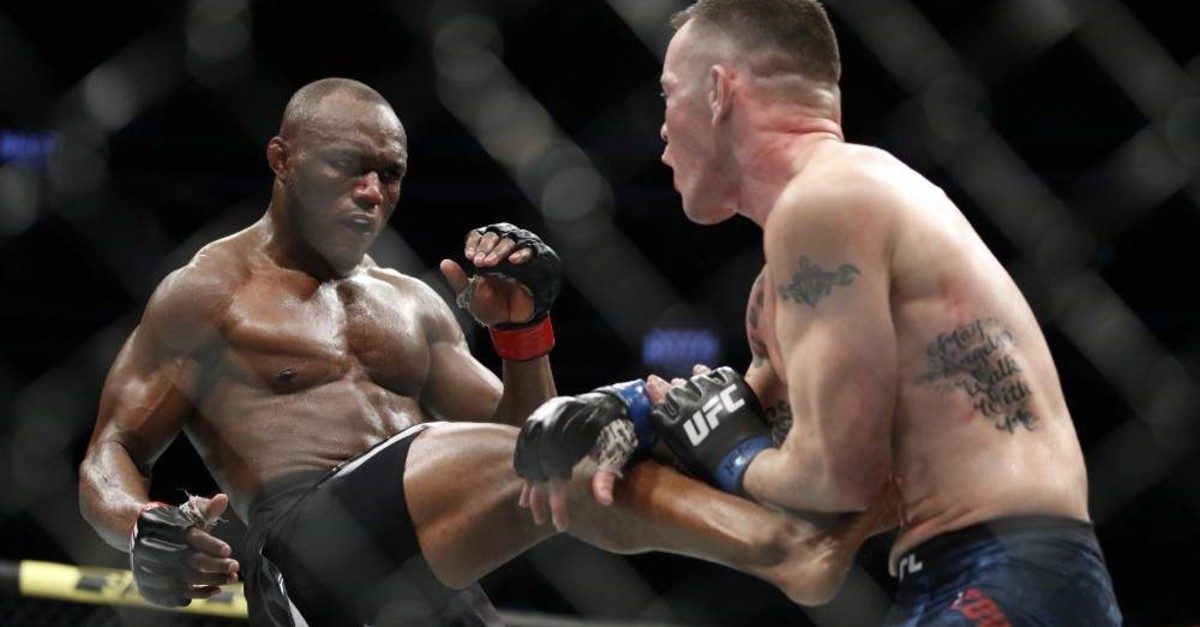 Usman lands a well-timed front kick against Covington in their mixed martial arts welterweight championship bout at UFC 245 in Las Vegas, Dec. 14, 2019. (AP Photo)