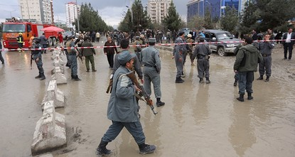 pA suicide attacker blew himself up outside a wedding hall in Kabul killing at least nine people, officials said Thursday, in an apparent attempt to strike a political gathering under way...