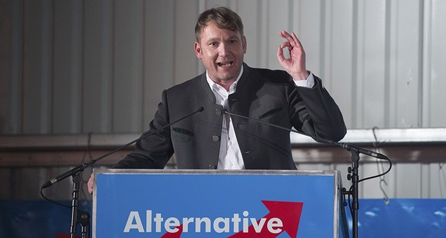 In this Feb. 14, 2018 photo Andre Poggenburg, head of the nationalist AfD in German state of Saxony-Anhalt, speaks during a party rally in Nentmannsdorf near Pirna, eastern Germany, where he insulted Turkish people. (AP Photo)