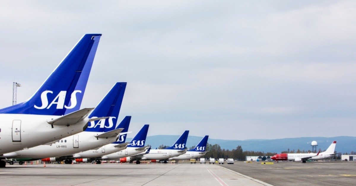 SAS planes are seen grounded at Oslo Gardermoen airport during pilots strikes, in Oslo, Friday, April 26, 2019. (AP Photo)