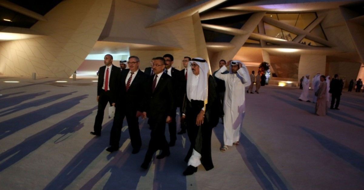 Vice President Fuat Oktay (C) and former Qatari culture minister Hamad bin Abdoulaziz Al-Kawari (R) arrive at the inauguration ceremony of the National Museum of Qatar in the capital Doha, ahead of its official opening on March 27, 2019. (AFP Photo)
