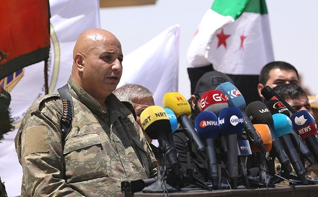 SDF spokesman Talal Sillo speaks during a press conference in Hukoumiya village in Raqqa, Syria, on June 6, 2017. (Reuters Photo)