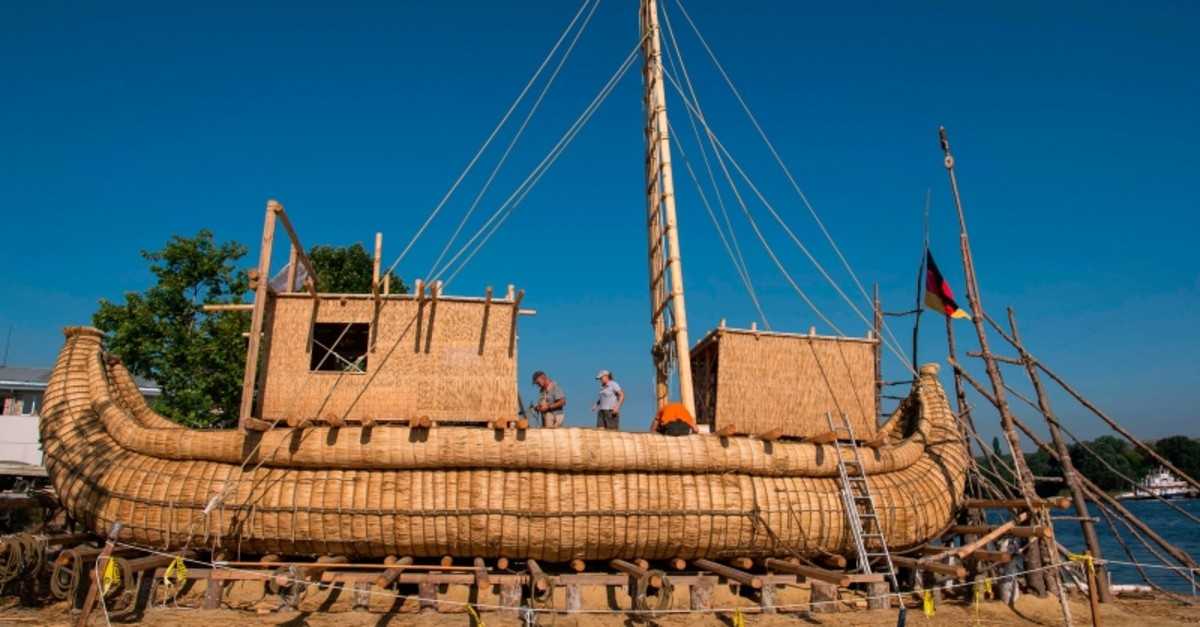 Members of the crew assemble the 14-meter long sailing reed boat Abora IV in the town of Beloslav, Bulgaria, on July 25, 2019 (AFP Photo)