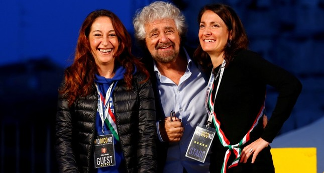 Beppe Grillo (C), the founder of the anti-establishment 5-Star Movement, is seen with party members during a march in opposition to the constitutional reform referendum in Rome.