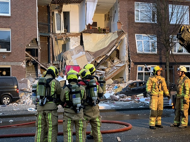 Authorities respond after a three-story home collapsed in The Hague, Netherlands on Sunday, Jan. 27, 2019. (AP Photo)