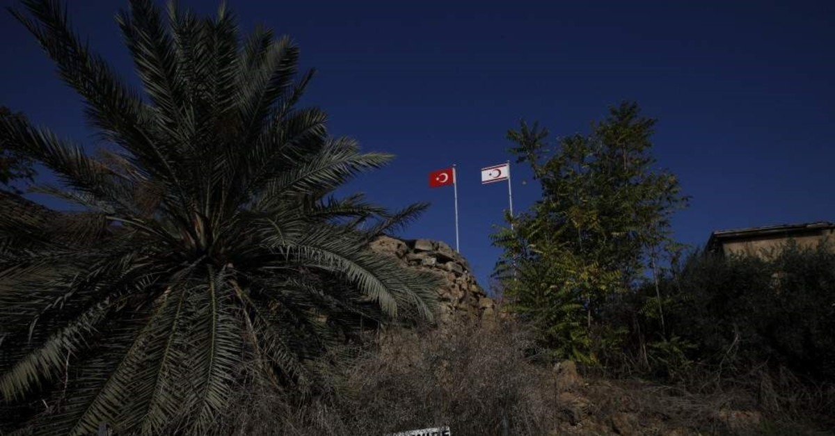 A Turkish flag and a Turkish Cypriot flag at a guard military post inside the U.N buffer zone in the divided capital Nicosia, Nov. 5, 2019. (AP)