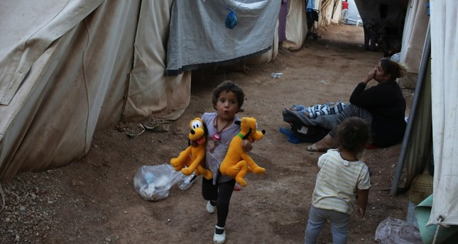 A little girl running among tents at Ritsona refugee camp, which hosts about 600 refugees and migrants, north of Athens, Sept. 12, 2016.