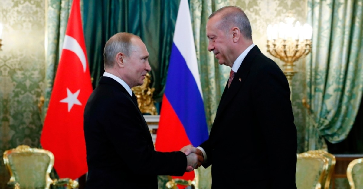 Russian President Vladimir Putin (L) shakes hands with President Recep Tayyip Erdou011fan (R) ahead of a meeting at The Kremlin in Moscow on April 8, 2019. (AFP Photo)
