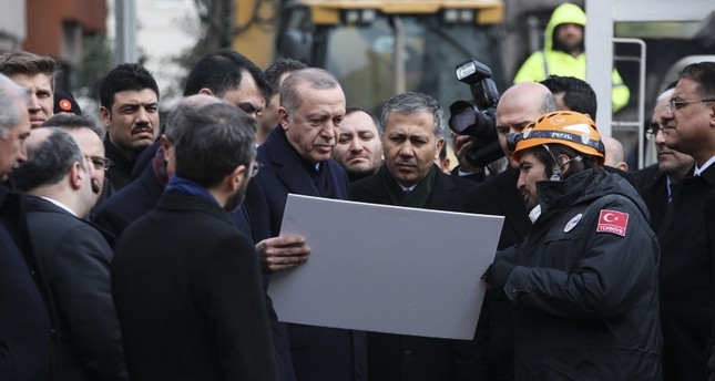 President Recep Tayyip Erdoğan visits the building collapse site on Feb 9, 2019 in Istanbul. (AA Photo)