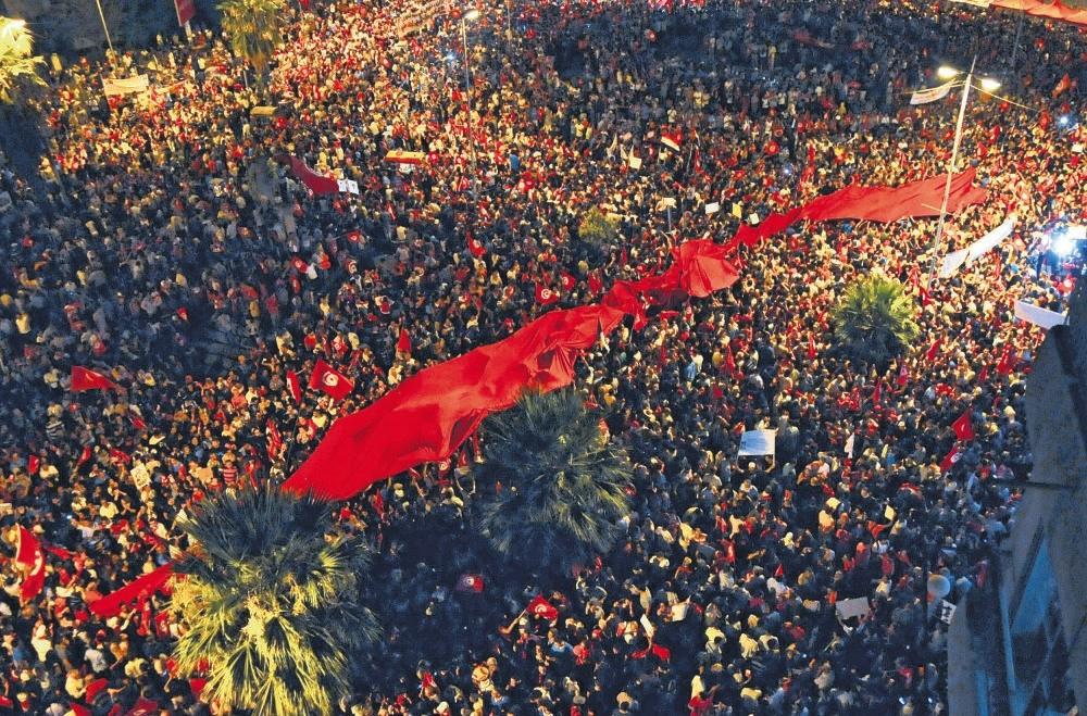Citizens protest against Tunisia's government, Aug. 6, 2013 in Tunis.