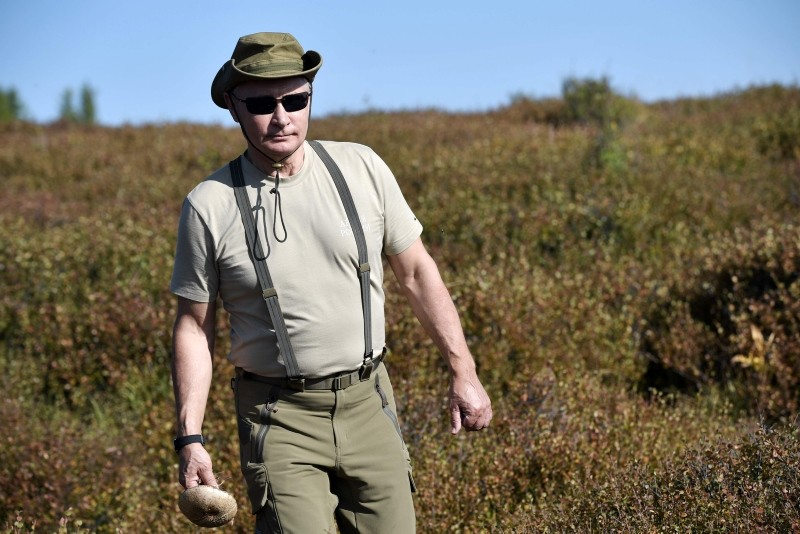 A photo made available on 27 August 2018 shows Russian President Vladimir Putin on an outdoor trip during his visit in the Tuva region in Siberia, Russia, 26 August 2018.