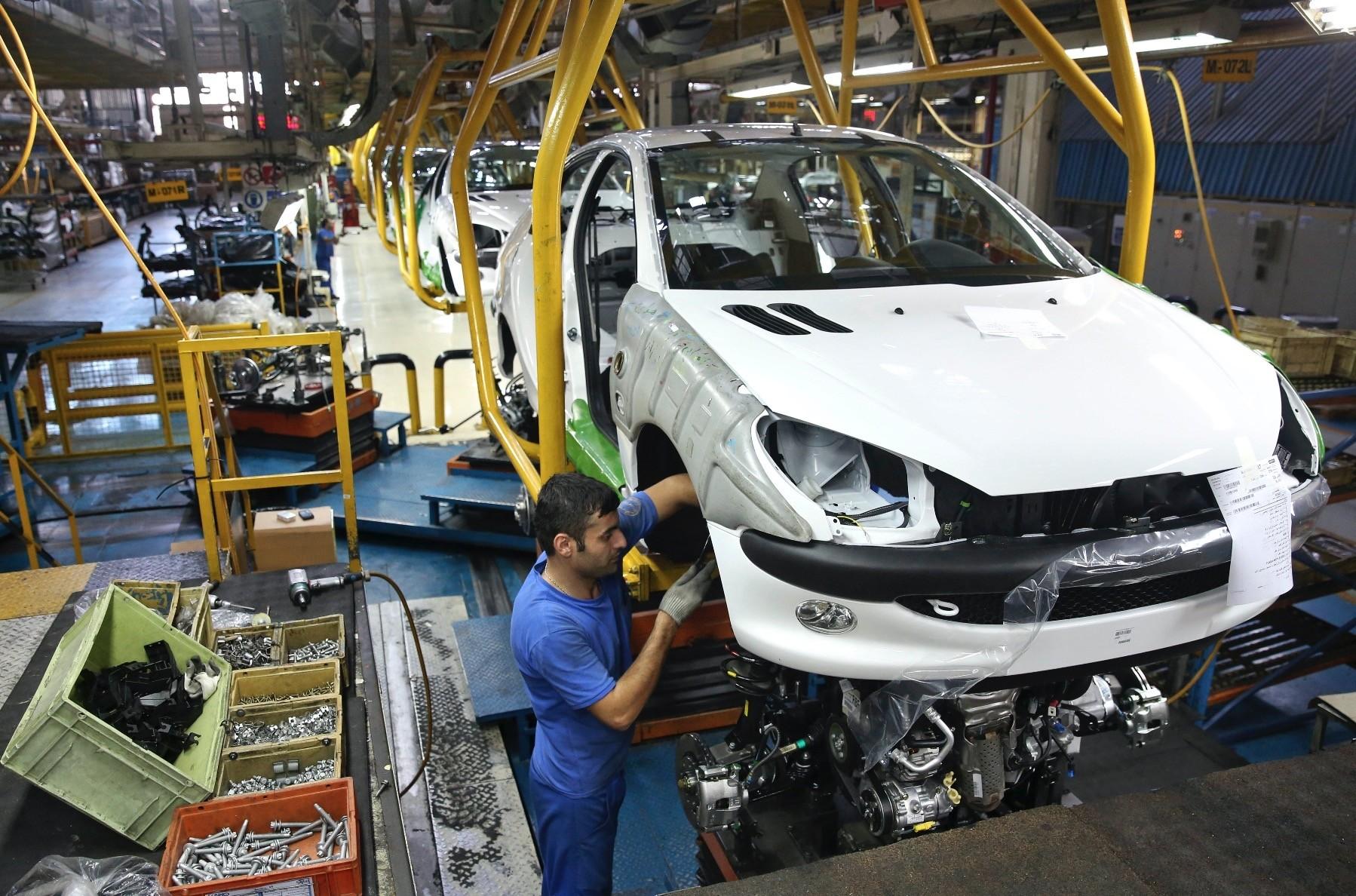 An Iranian worker assembles a Peugeot 206 at the state-run Iran-Khodro automobile manufacturing plant near Tehran, Iran.