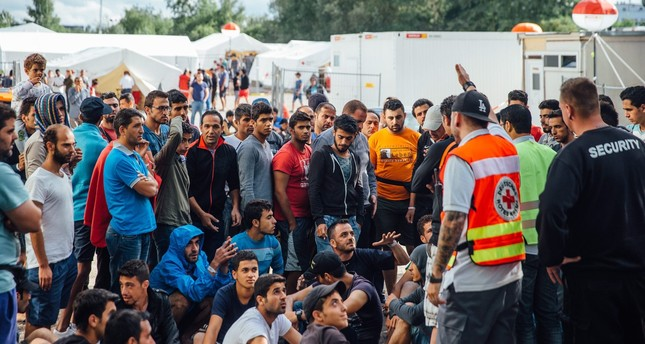 Amnesty report states Germany fails to protect refugee shelters