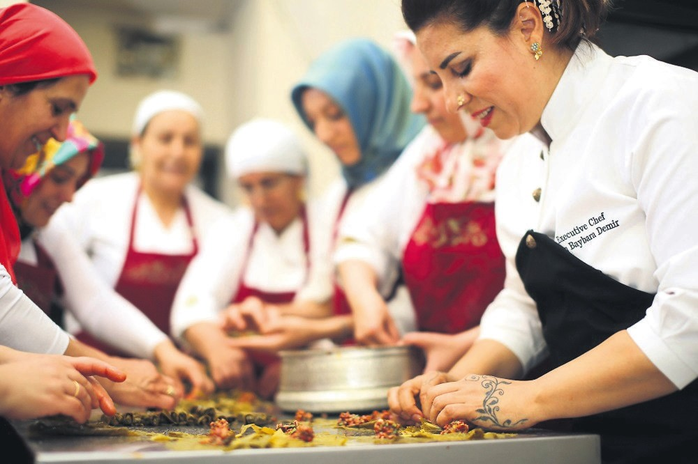 Entrepreneur chef Ebru Baybara Demir, right, working with her fellow cooks.
