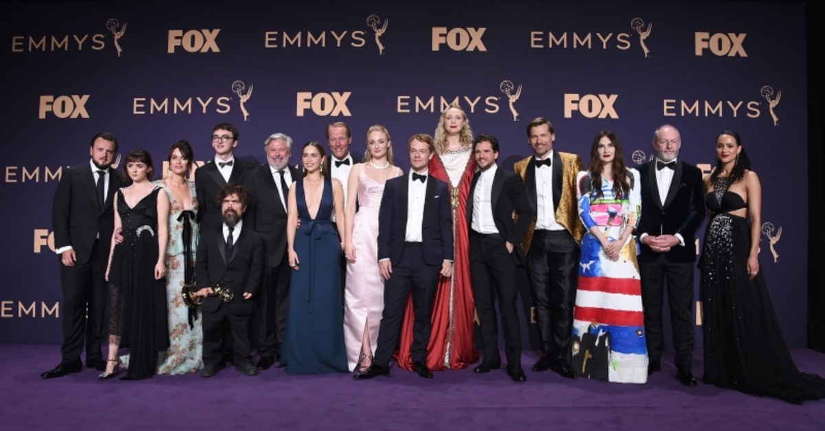 The cast of ,Game of Thrones,, winners of the award for outstanding drama series, pose in the press room at the 71st Primetime Emmy Awards. (AP Photo)
