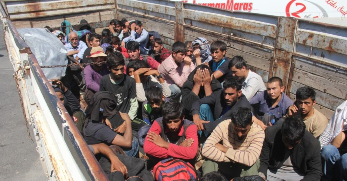 Migrants huddled together in the back of a truck in the southern city of Adana, Sept. 10, 2019. Sixty-one illegal migrants were discovered inside the truck heading to Istanbul.