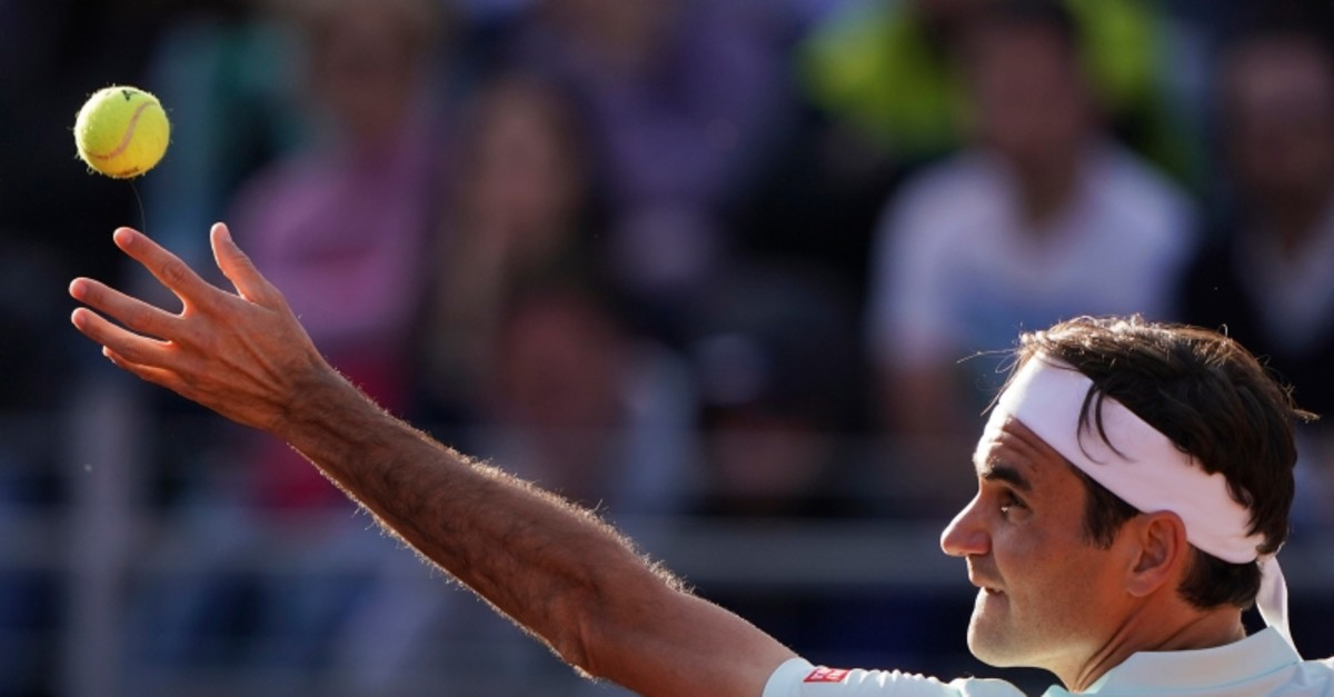 Roger Federer of Switzerland serves the ball to Borna Cedric of Croatia at the Italian Open tennis tournament, in Rome, Thursday, May 16, 2019. (AP Photo)