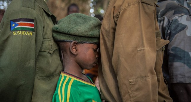 A newly released child soldier waits in a line for his registration during a ceremony in Yambio, South Sudan, Feb.7.