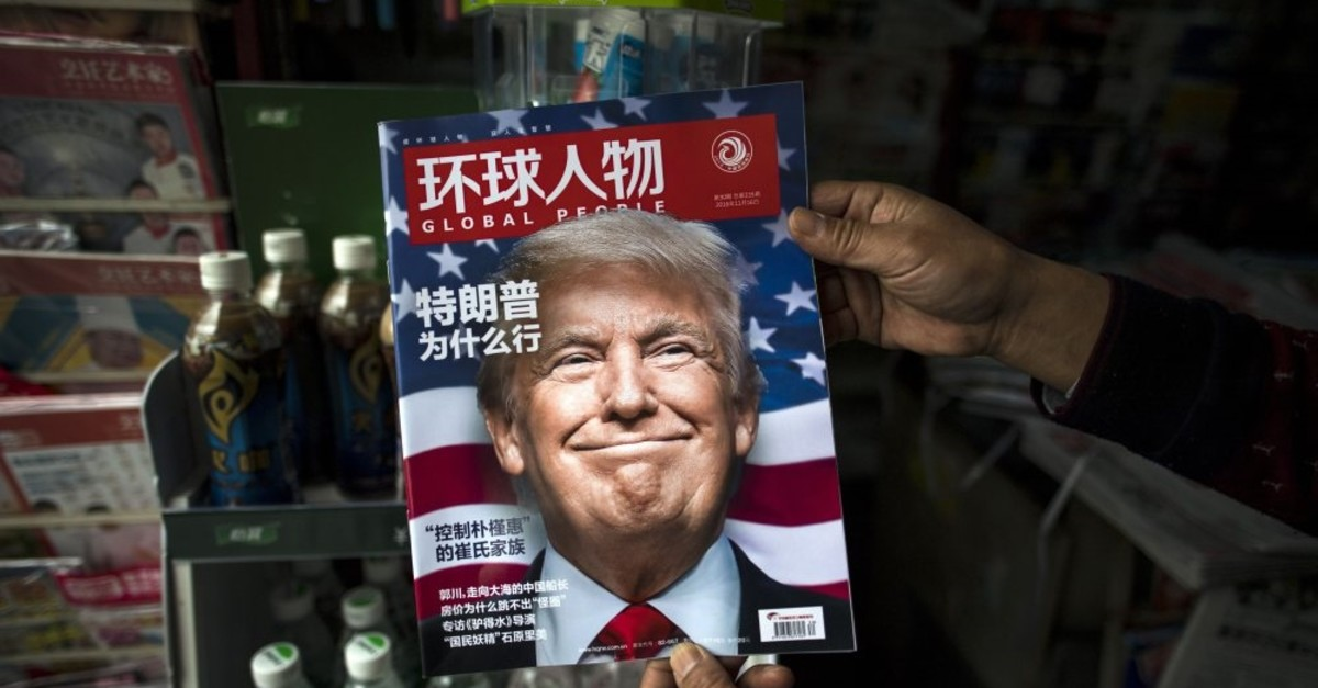 A copy of the local Chinese magazine Global People with a cover story that translates as u2018Why Did Trump Win?' at a news stand in Shanghai, Nov. 14, 2016.
