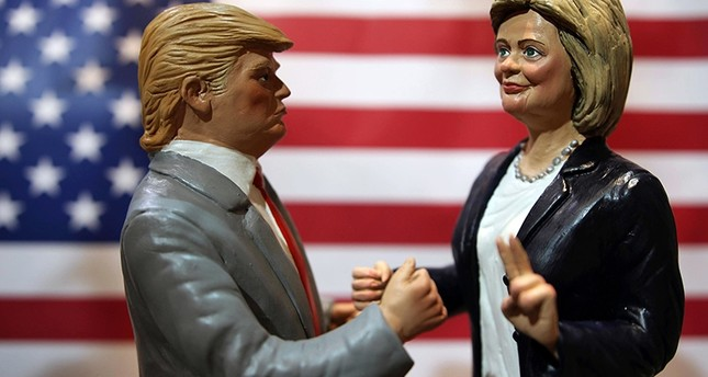 Statuettes depicting the presidential candidates Donald Trump, left, and Hillary Clinton are displayed in a shop in Via San Gregorio Armeno, the street of nativity scene craftsmen, in Naples. (AP Photo)
