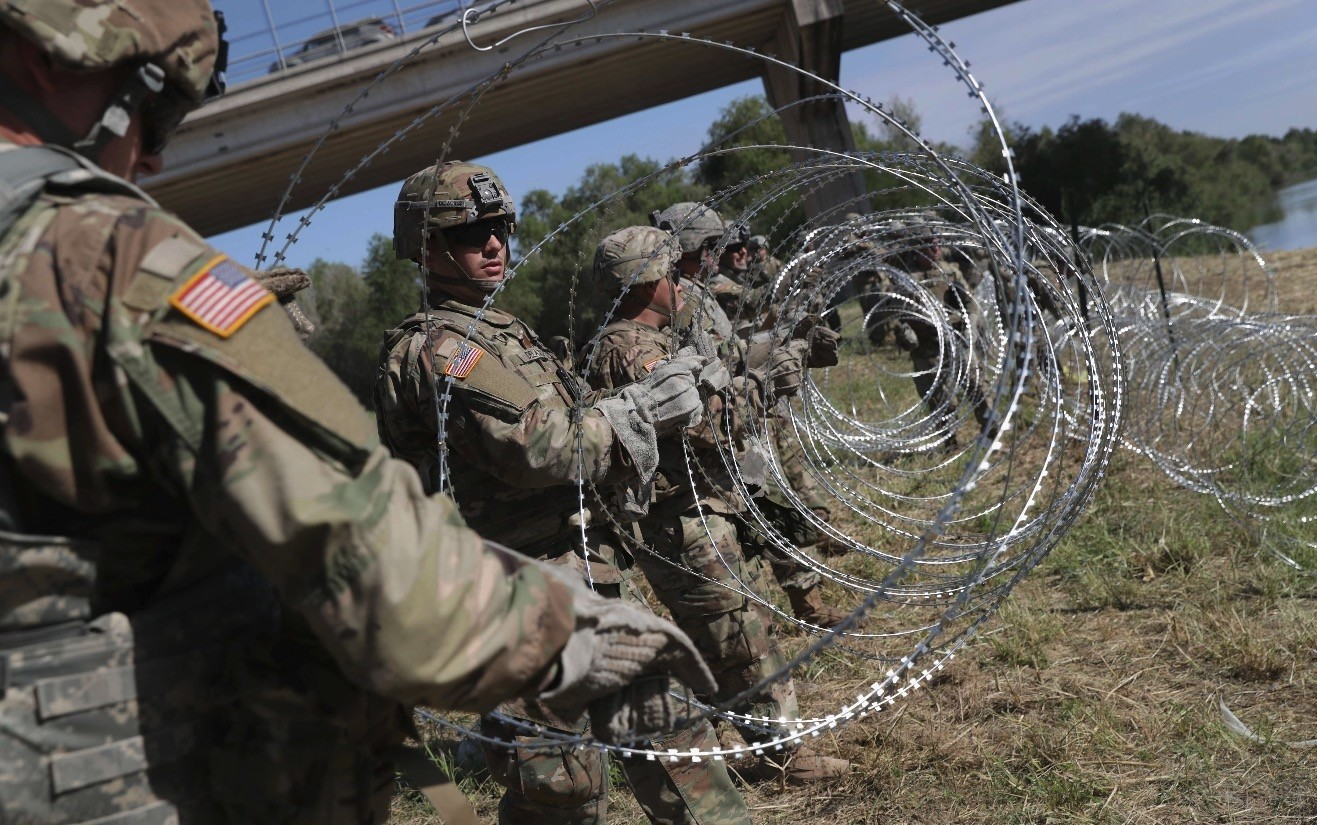 U.S. Army  active-duty troops install protective wire along the Rio Grande at the U.S.-Mexico border as part of President Trump's recent order on the migration issue, in Hidalgo, Texas, Nov. 2.