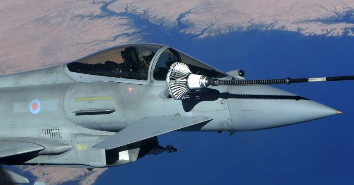 This Sept. 21, 2016, file photo, shows the U.K. Royal Air Force Eurofighter Typhoon fighter jet refueling from a tanker aircraft during an anti-Daesh coalition mission over central Iraq. (AFP Photo)