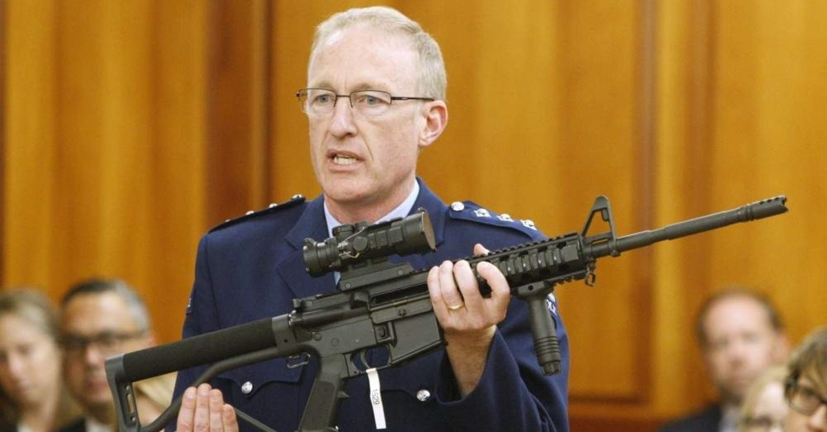 In this April 2, 2019, file photo, police acting superintendent Mike McIlraith shows New Zealand lawmakers an AR-15 style rifle similar to one of the weapons a gunman used to slaughter 51 worshippers at two Christchurch mosques, in Wellington, New Zealand. (AP Photo)