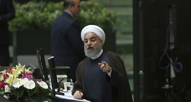 Iranian President Hassan Rouhani speaks in a session of parliament to debate his proposed cabinet, in Tehran, Iran, Tuesday, Aug. 15, 2017 (AP Photo)