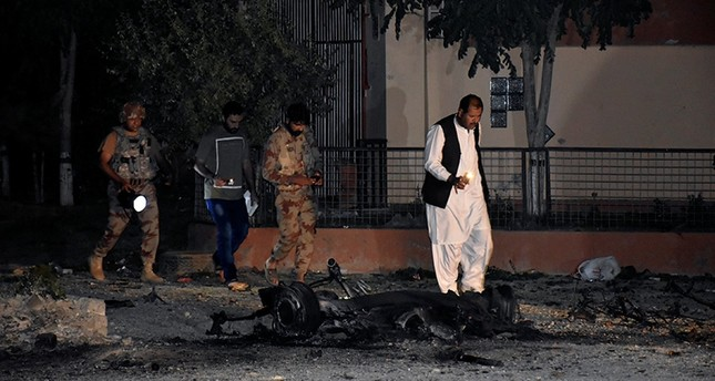 Security officers and paramilitary soldiers survey the site, after five suicide bombers tried to drive a vehicle laden with ammunition and explosives into a military facility in Quetta, Pakistan May 17, 2018. (Reuters Photo)