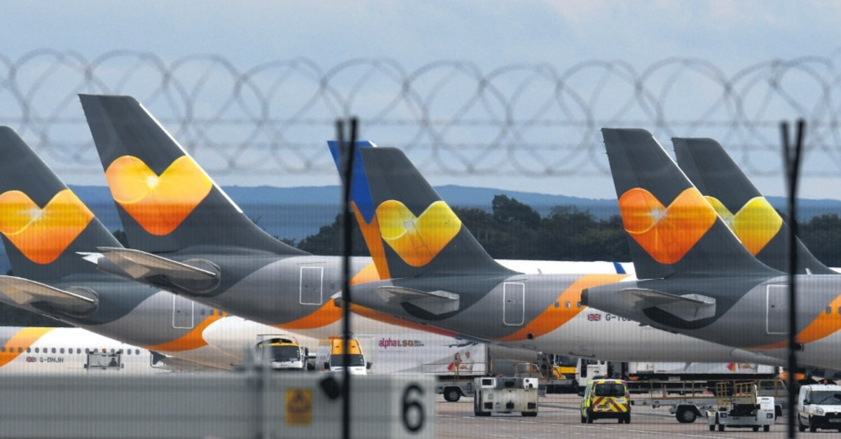 Thomas Cook logos pictured on the tailfins of the company's passenger aircraft parked on the tarmac at Manchester Airport in Manchester, after the company collapsed into bankruptcy, Sept. 23, 2019.