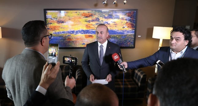Foreign Minister Mevlüt Çavuşoğlu answers reporters' questions following Cyprus talks in the Alpine resort of Crans-Montana, Switzerland on June 29, 2017. (AA Photo)