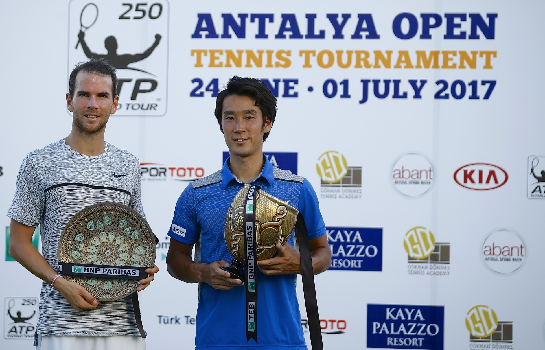 Sugita (R) downed Mannarino 6-1, 7-6(4) for his first ATP World Tour title at the Antalya Open to win the big prize.