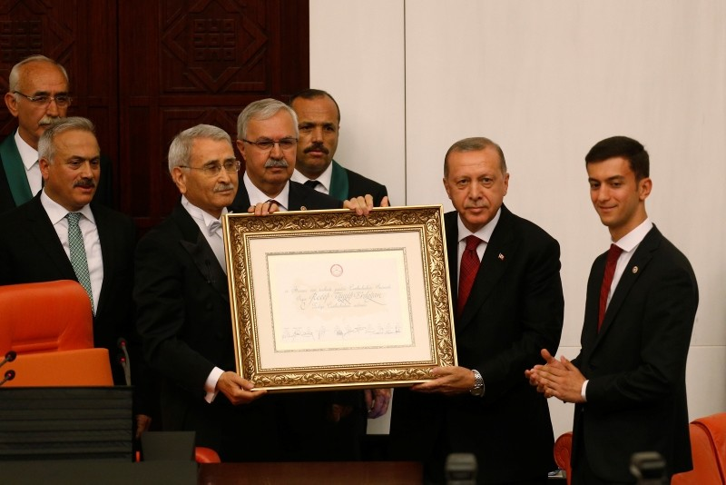 Erdoğan, 2nd right, arrives at the parliament to take the oath of office for his second term as president, in Ankara, July 9, 2018.