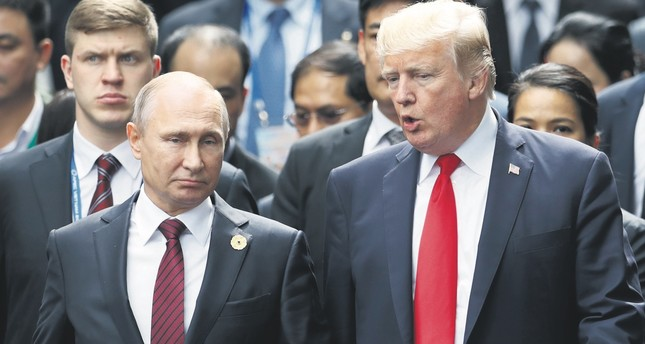 U.S. President Donald Trump and Russia's President Vladimir Putin talk at the APEC Summit in Danang, Vietnam, Nov. 11, 2017.